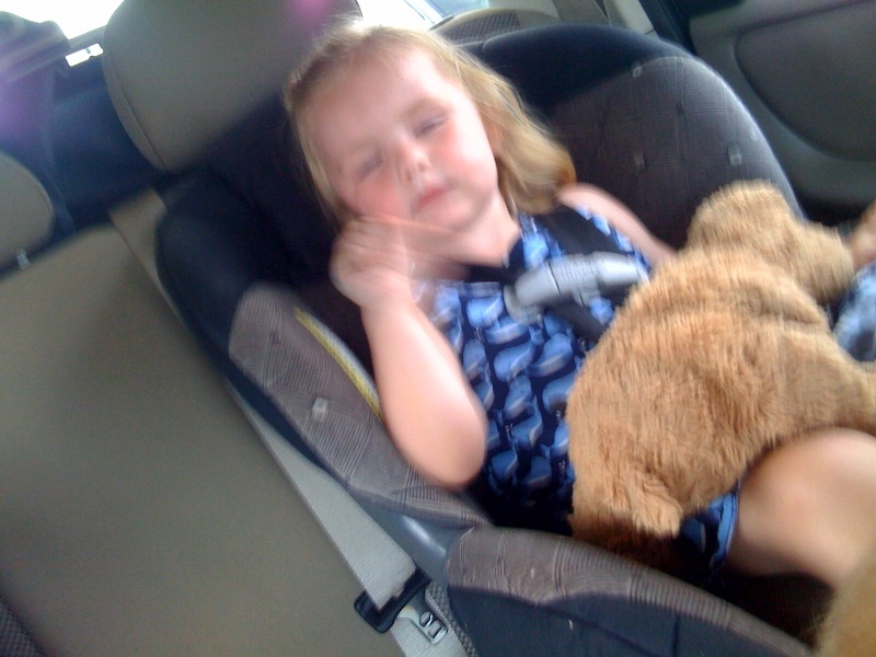 Fist pumpin' to the music even in her sleep!  :)